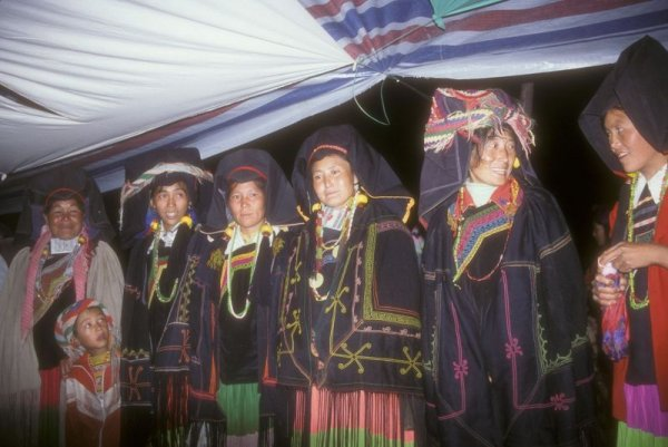 Nuosu Yi 5. Shynra women singing laments at the funeral of an elder.  Each wears a pleated skirt, a mother