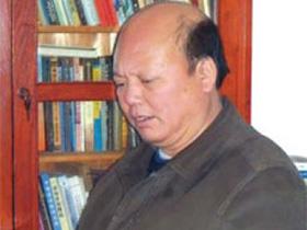 传承彝族文化的使者——记毕节地区彝文文献翻译研究中心主任王继超