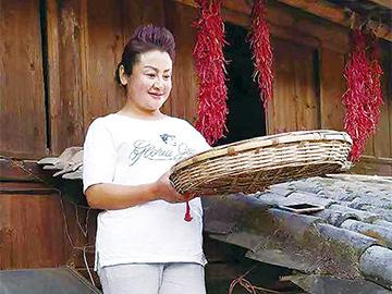 罗丽萍:彝乡文化带我富起来