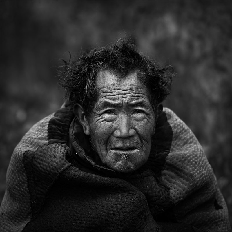 Portrait of an old man. Photo by He Qinming. [Photo provided by photoint.net]